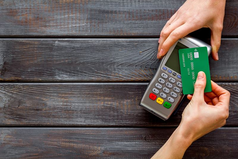 Green Debit Card being used